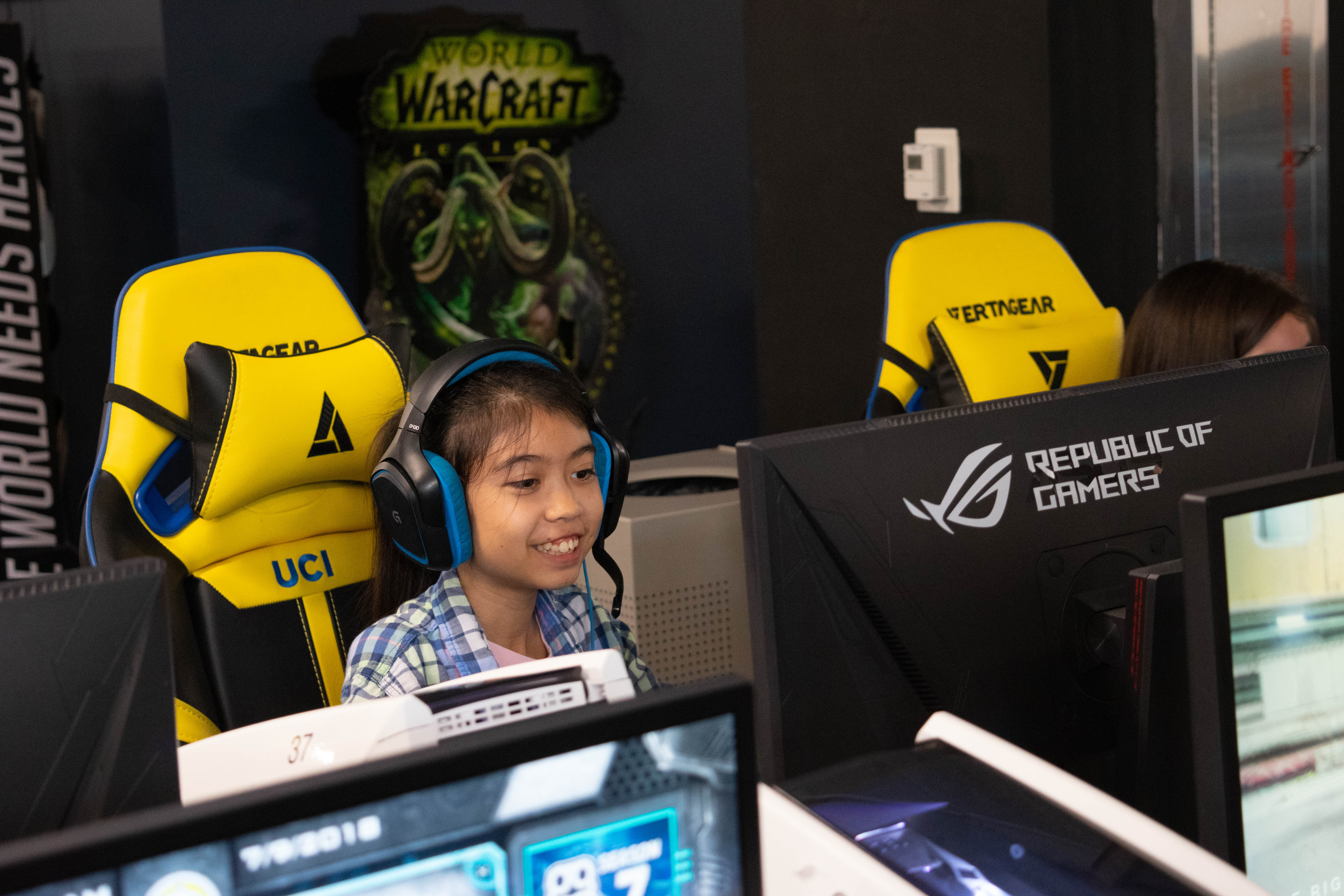 One of the campers enjoying a game of League of Legends with UCI Esports' Championship Team.